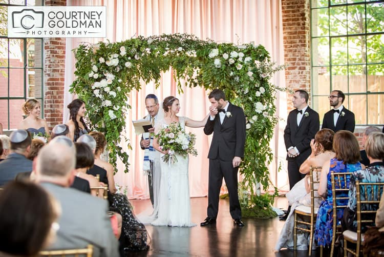 Jewish Wedding Ceremony under Floral Chuppah at The Foundry at Puritan Mill by Courtney Goldman Photography 35