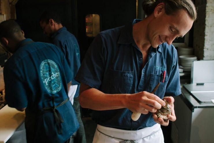 Chef Ryan Prewitt of Peche New Orleans Shucking an Oyster