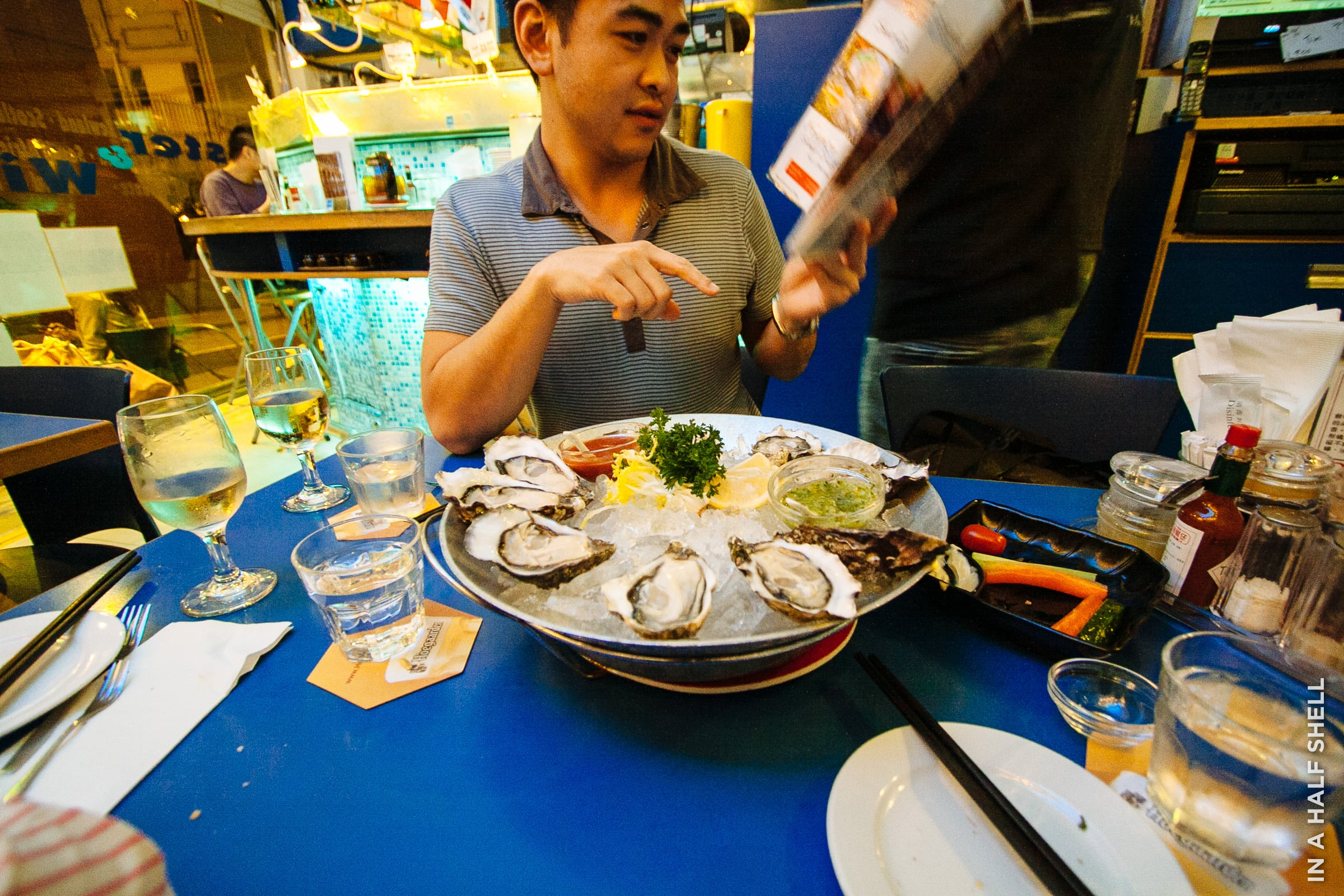 Enjoying international oysters with friends in Hong Kong