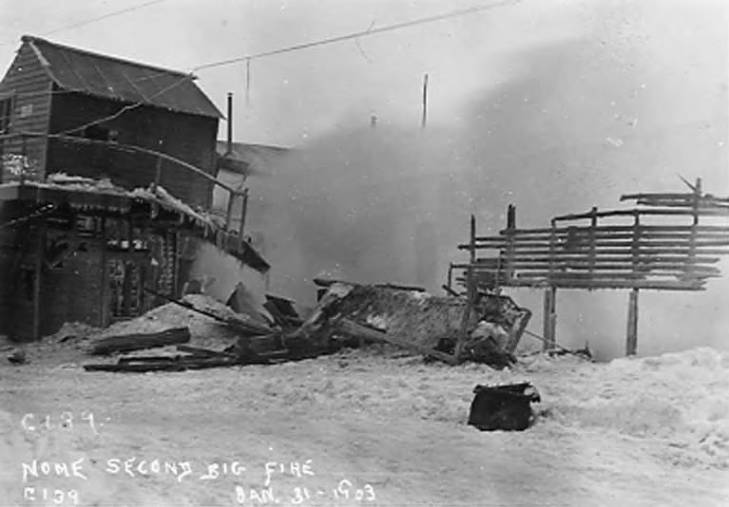 Collapsed and smoking burned building during Nome's 1903 fire, January 31, 1903.jpg
