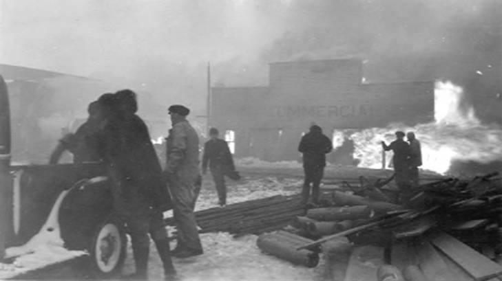 Building on fire, with men and truck in foreground, Nome, 1934.jpg