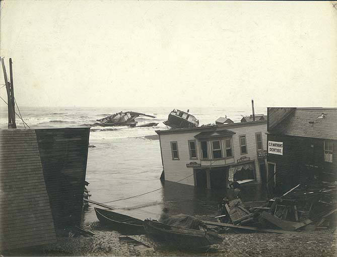 Wreckage of buildings and boats on the sand spit near the mouth of the Snake River following the storm at Nome, Alaska, September 14, 1900.jpg