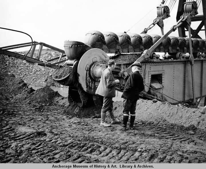 Frank Reeds and Arthur Baldwin standing alongside gold dredge. Nome, Alaska. july 1938.jpg