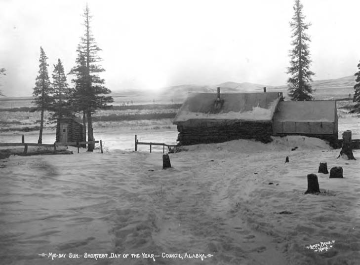 Cabin in snowy valley with sun setting over mountains, Council, Alaska, 1908-1920.jpg
