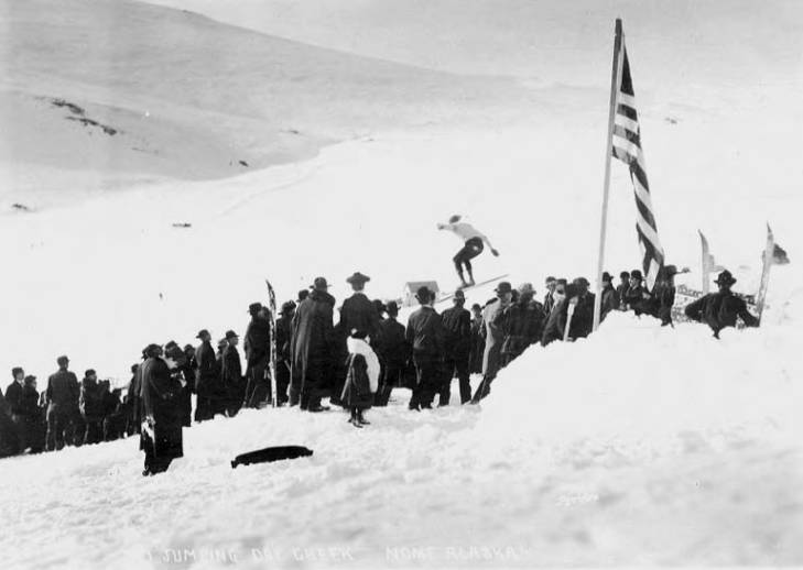 Crowd watching ski jumper at Dry Creek near Nome, Alaska, circa 1905.jpg