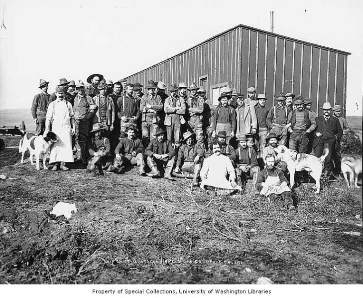 Day shift miners at the Northern Light Mining Company, Ophir Creek, Alaska, between 1900 and 1910.jpg