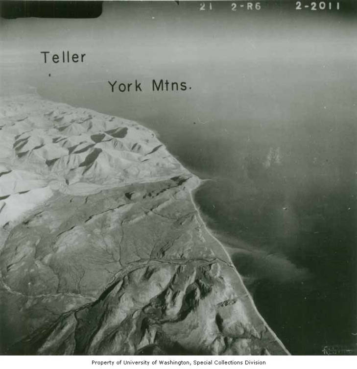 erial view southeast over York Mountains on the south side of Seward Peninsula, Alaska with Teller, Cape Spencer, and Port Clarence in the background, between 1944 and 1957.jpg