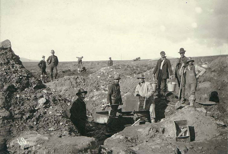 Excavation and miners at Mattie placer mine near Anvil Creek, Nome District, Alaska between 1898 and 1900.jpg