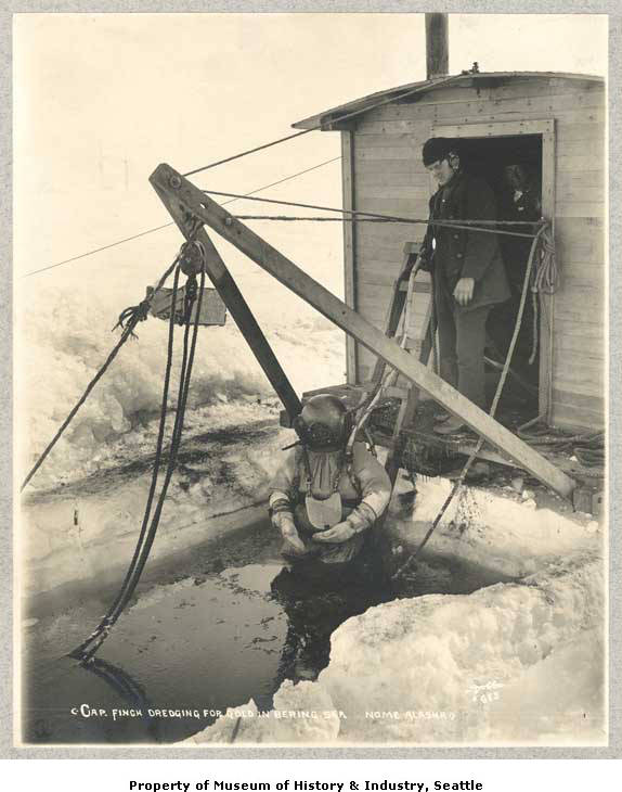 Father and son dredging for gold in the Bering Sea, ca. 1904.jpg