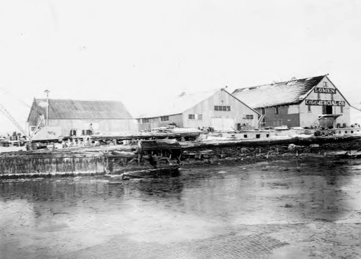 Lomen Commercial Company warehouse after 1945 storm viewed from the harbor, Nome, Spring 1946.jpg