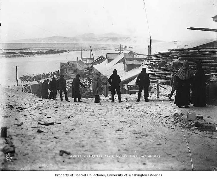 Men working a bucket line at the Ophir Saloon fire, Council, December 30, 1904.jpg