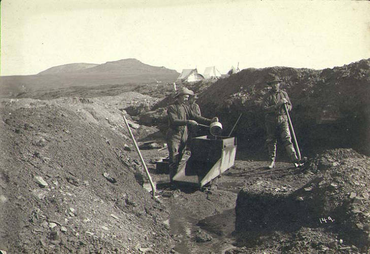 Miners operating rocker box at the mouth of Nekula Gulch, Nome District, Alaska, between 1898-1900.jpg
