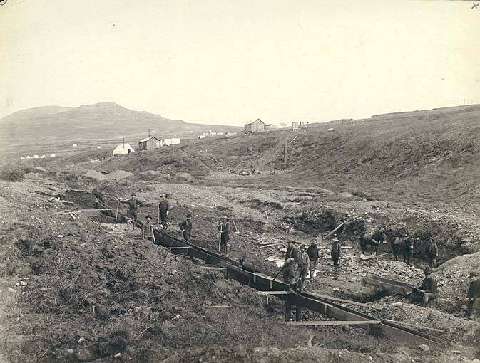 Miners operating sluice along Anvil Creek in Nome District, Alaska, between 1898-1900.jpg