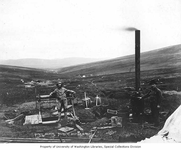 Mining operation at the head of Dexter Creek showing two men with mining equipment, Alaska, circa 1907.jpg