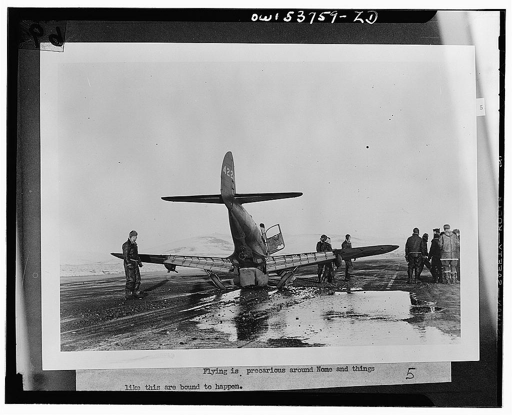 Nome, Alaska. A wrecked plane, probably at the Alaska wing base of the Air Transport Command.jpg
