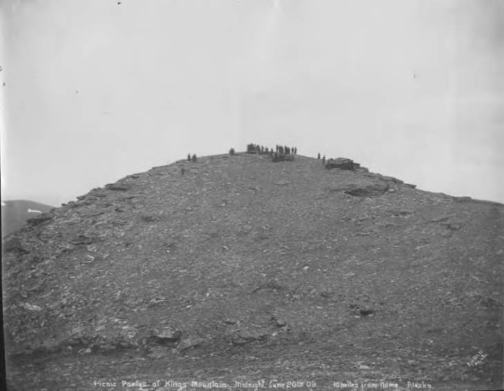 People picnicking on Kings Mountain at midnight near Nome, Alaska, June 20, 1909.jpg