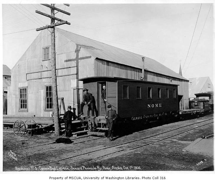 Seward Peninsula Railway car and warehouse, Nome, October 1, 1906.jpg