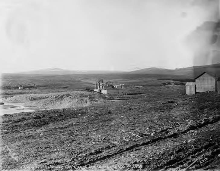 Three Friends Mining Company's operation showing dredge and mining dumps, vicinity of Nome, Alaska, October 1, 1905.jpg