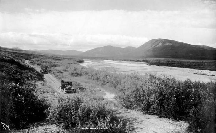 Two automobiles on a road in the Nome River Valley, Alaska, circa 1915.jpg