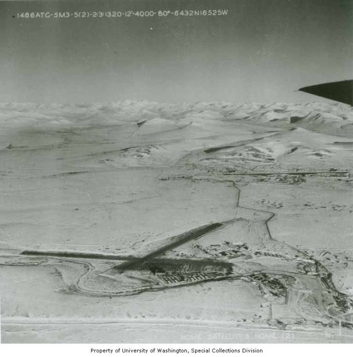 Aerial view north over Marks Airfield at Nome, Alaska with the Kigluaik Mountains in the background, February, 1945.jpg