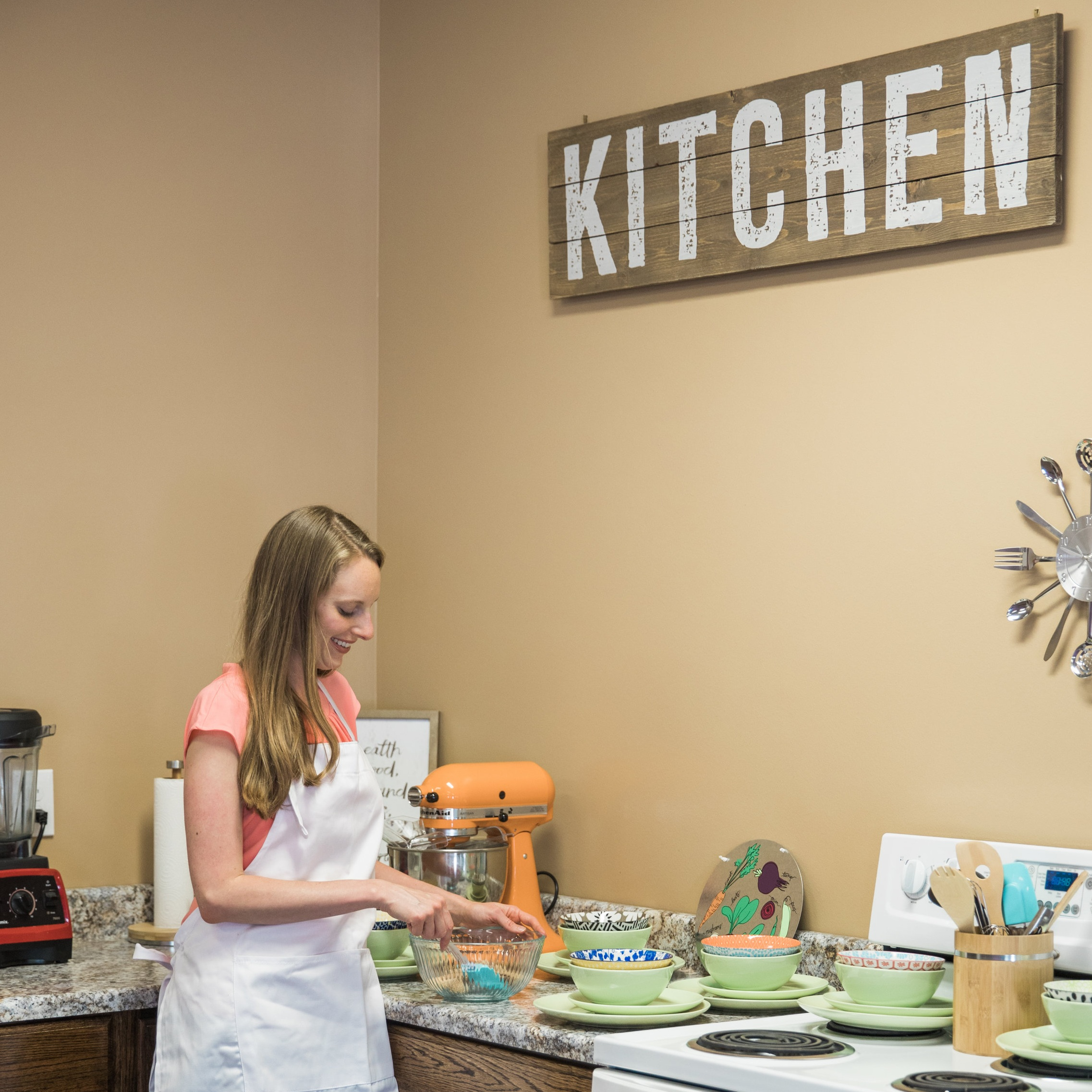 """Dr. Tucker in the """"Active Family Kitchen"""" - our former business in East Tennessee where families could come to learn more about whole food nutrition, feeding a family the healthy way and doctor-supervised cleanse/detox programs coupled with acupuncture, functional medicine and sauna services."""