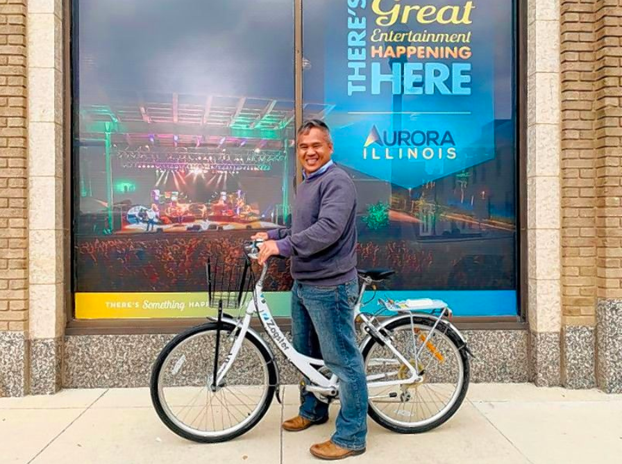 City of Aurora staffer Souts Thavong regularly uses the City's Zagster bike share program to enjoy downtown Aurora during lunch breaks.   Courtesy of City of Aurora