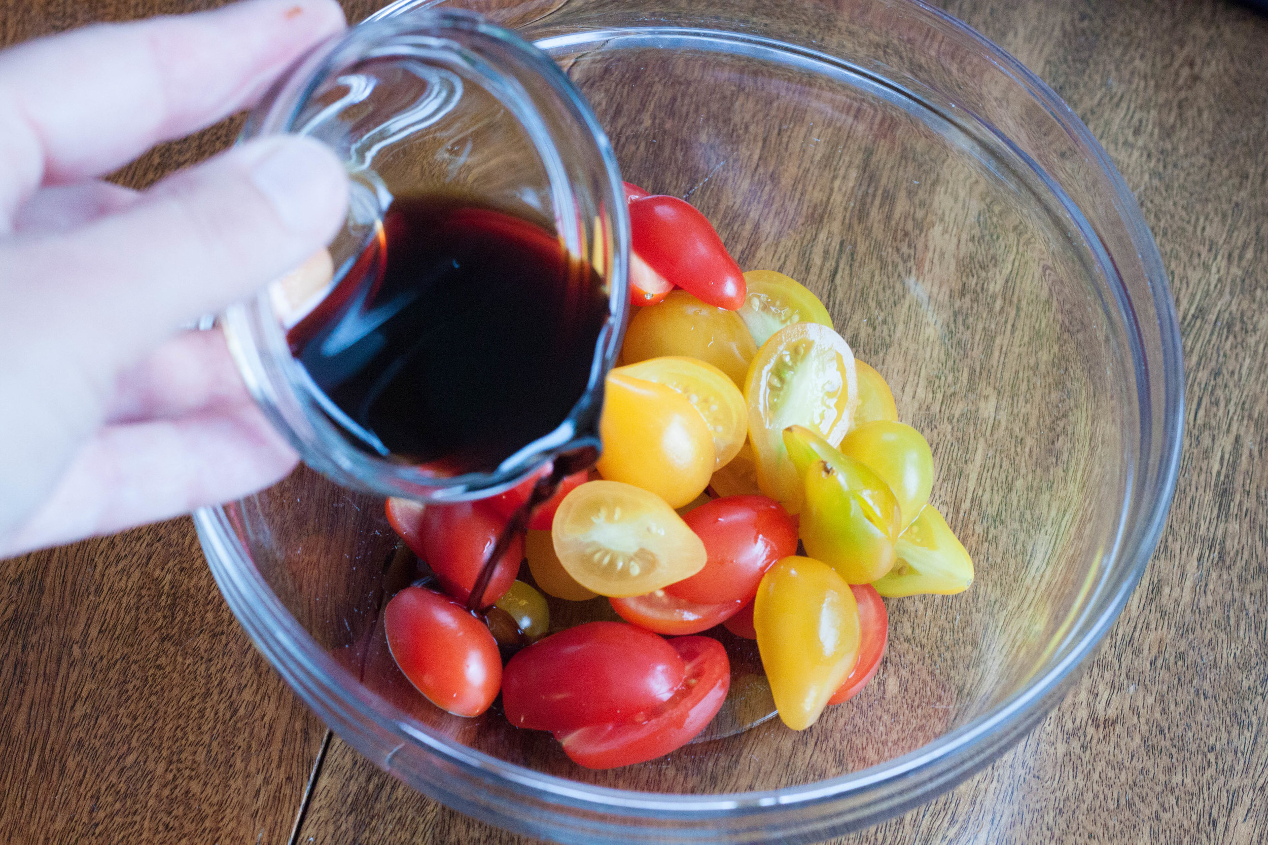 adding-balsamic-vinegar-to-cherry-tomatoes.jpg