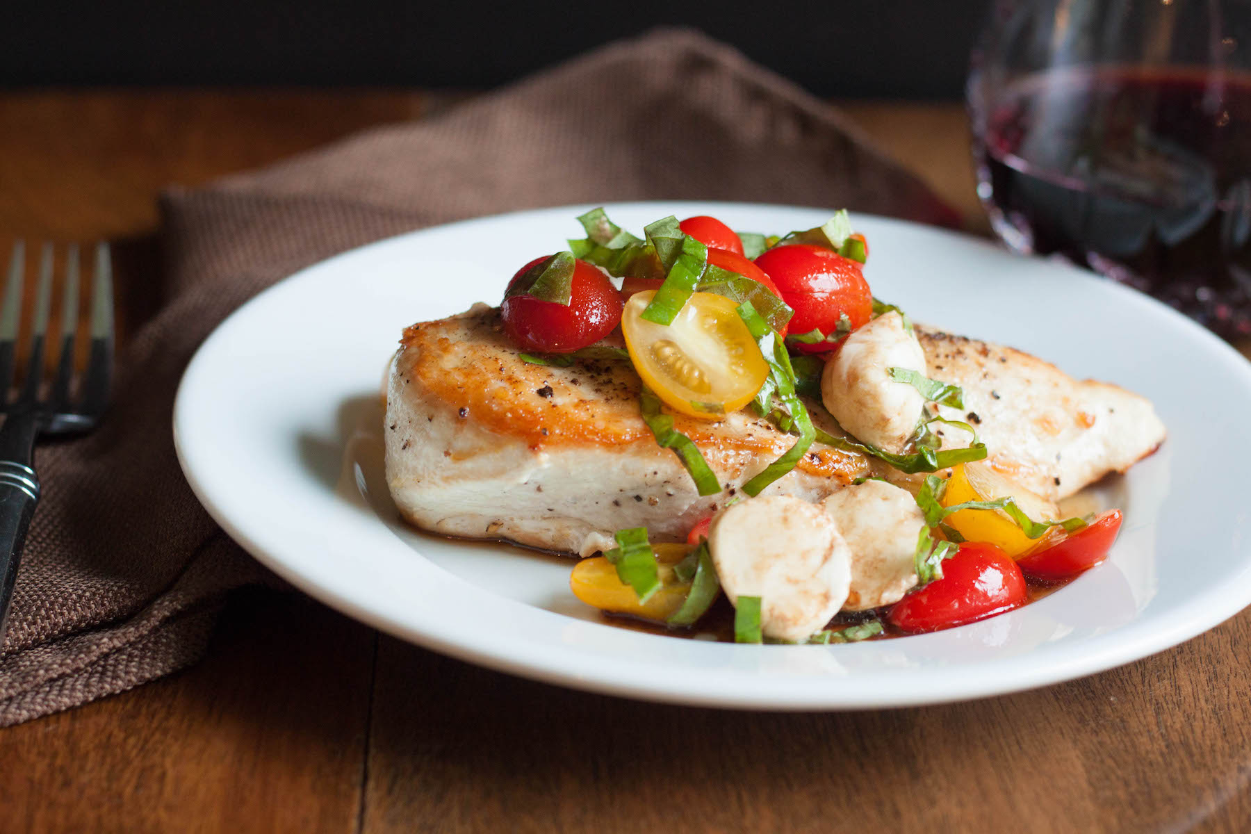 caprese-chicken-on-plate-with-red-wine.jpg