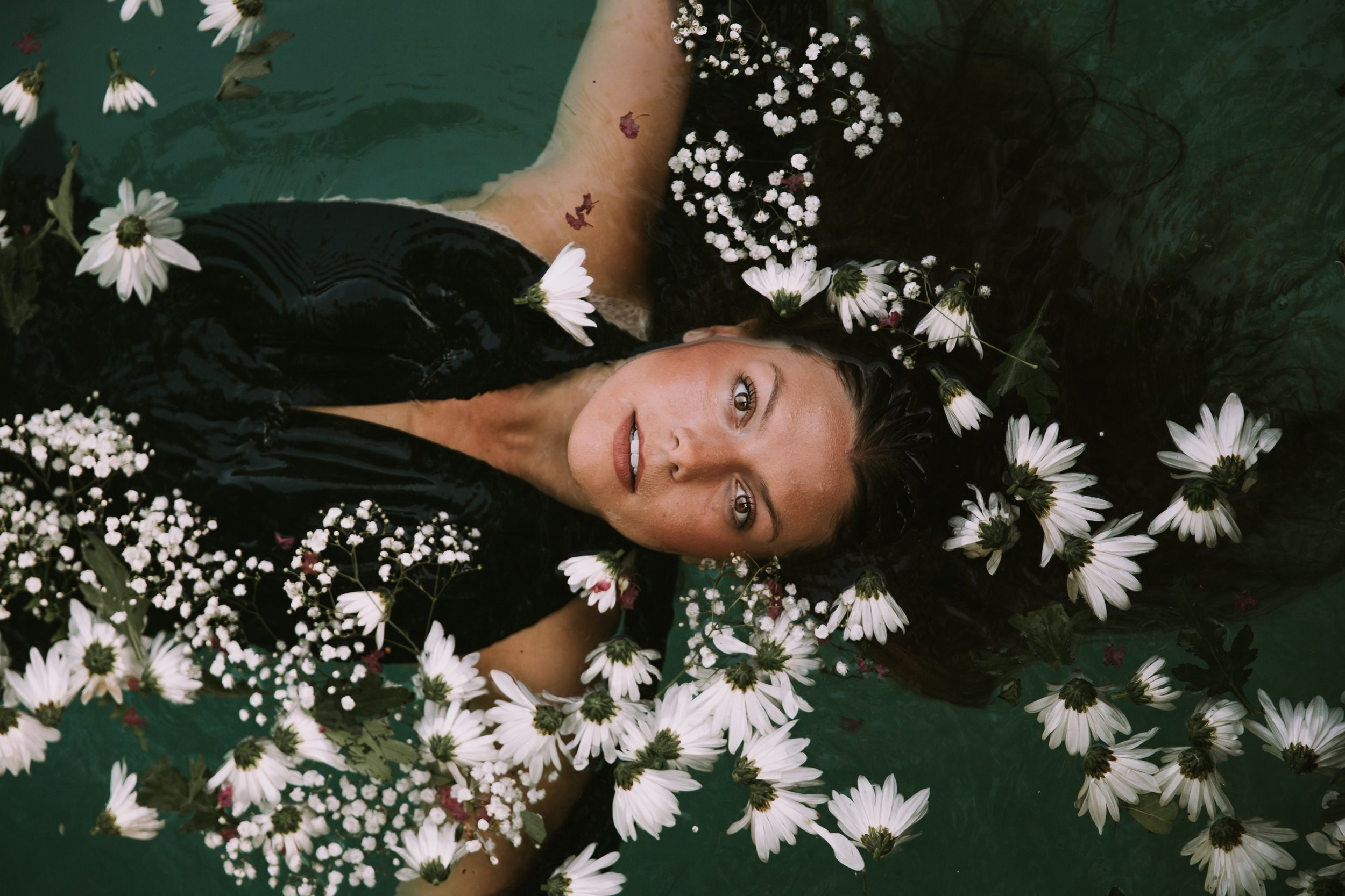woman in water with floating flowers.jpg