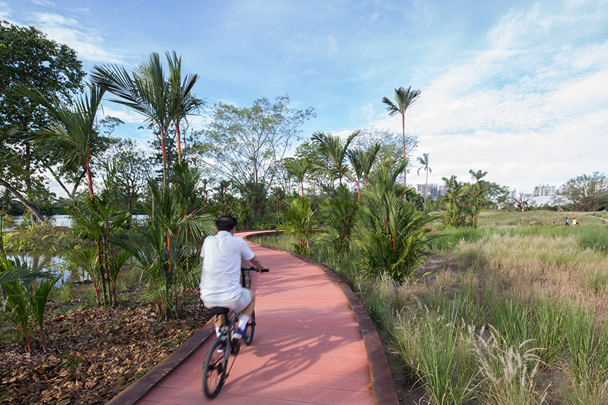A man cycling along Rasau Walk