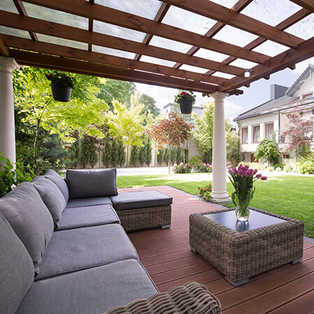 Seating under Arbor in Backyard