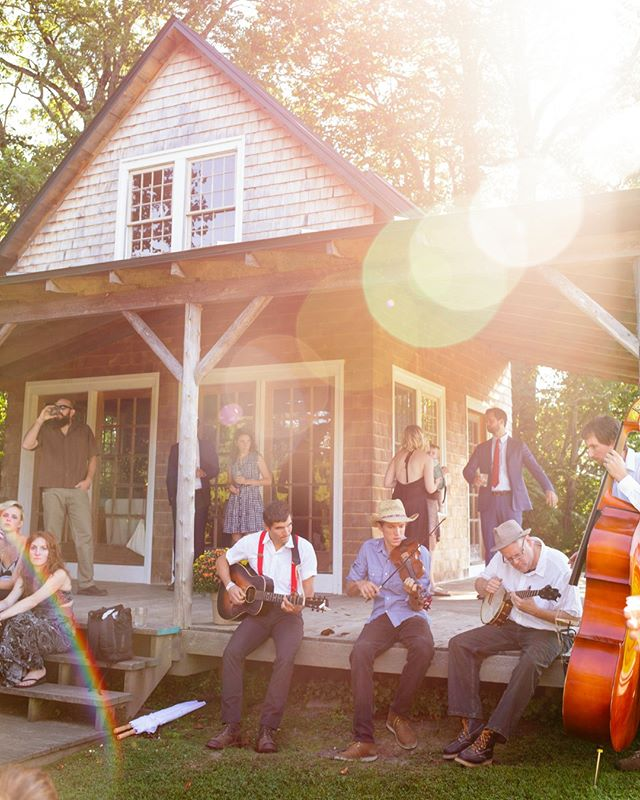 Guests bask in the warm summer sun as the folk band plays on the porch of this farmhouse in Vermont. Wedding was made complete with peak season produce, a myriad of berry pies, and freshly cut wildflowers all by @cedarcirclefarm (and homemade libations by the groom!)