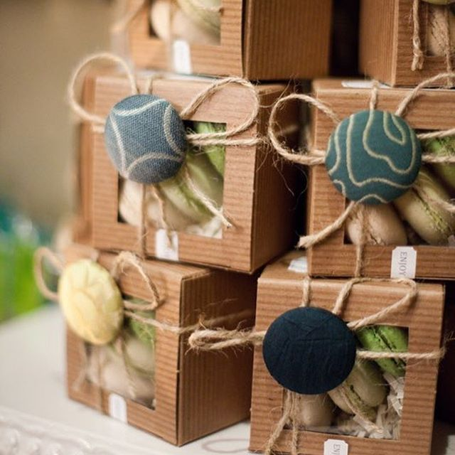 Add a personal touch to your wedding with favors that reflect something meaningful to you. If you can't decide, go all out like we did here - with a full on CULINARY FAVOR SHOP! Blood orange marmalade with a monogram wax seal, a trio of perfectly packaged French macarons, and candied kumquat lollipops!
