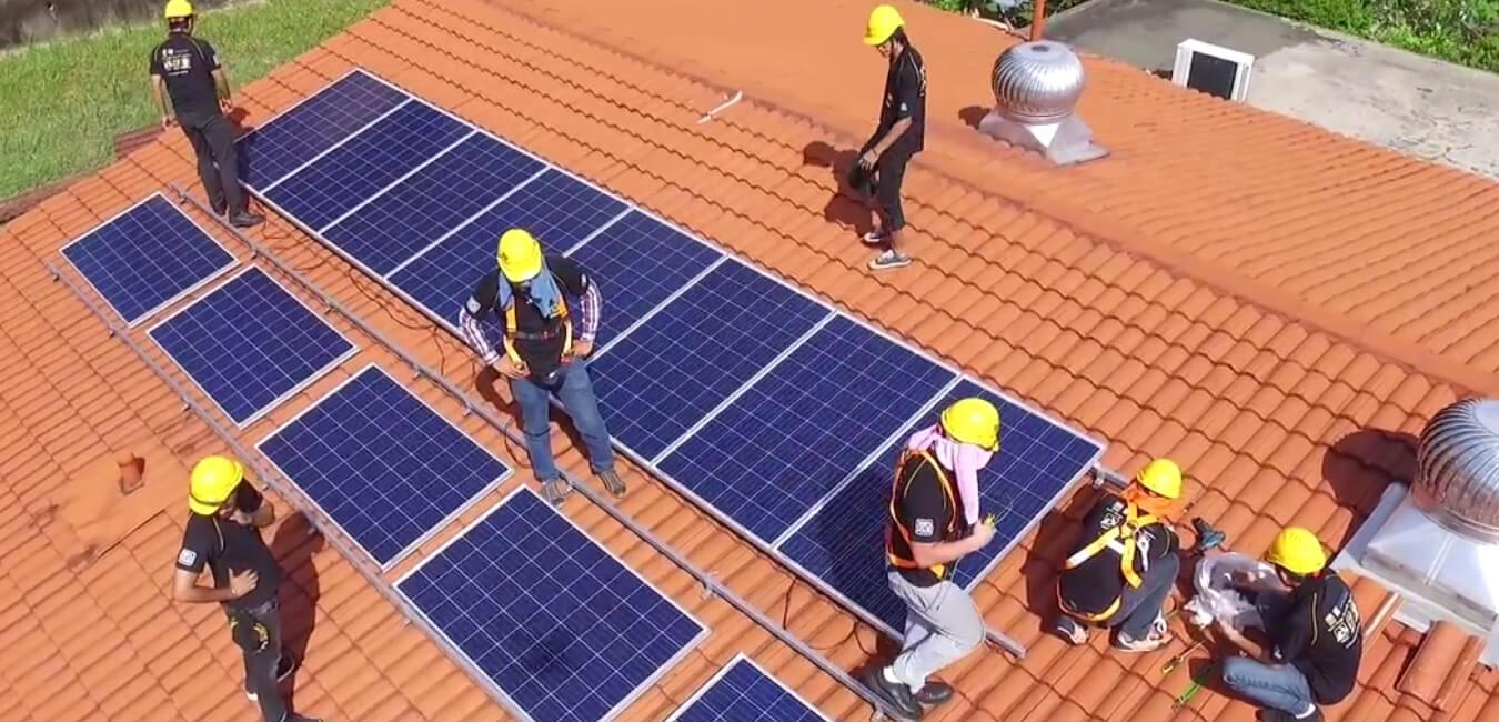 Installing-solar-panels-on-house-roof.jpg