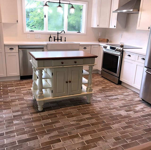#kitchendesign #kitchenrenovation complete overhaul of this dated space.  Removed walls, created accent features, brick flooring and wall, @fabuwood cabinets shaker white, #farmsink #corian
