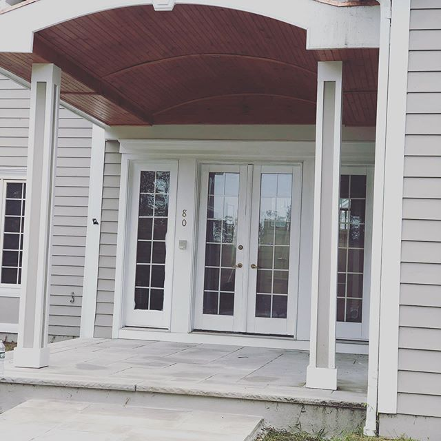 Complete overhaul and facelift to this beautiful home.  Replaced all rotted exterior wood, designed and built new massive #portico with tongue and groove curved underside and capped@off with a copper top!  New paint, doors, windows.  #pellawindows #construction #njcontractor #renovation #designbuild #dreams #limestone #grandentry