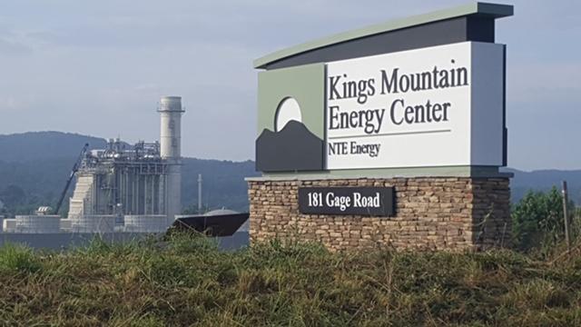 KMEC Sign and Plant.jpg