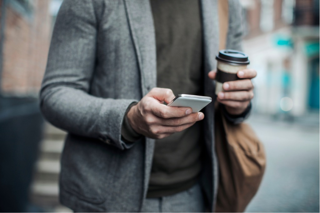 businessman-using-smart-phone-picture-id515473048.jpg