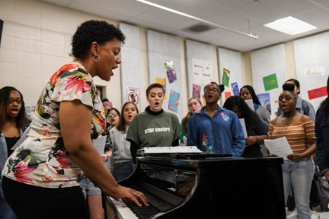 Music teacher Toni Daniels leads the student choir in song at Parkside High School in Salisbury on Tuesday, April 9, 2019.