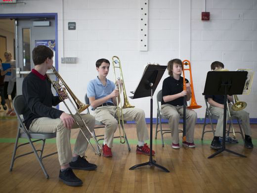 Horn students participate in a workshop with Andrew Houde of the Mid-Atlantic Symphony Orchestra Tuesday, March 17 in Selbyville. (photo by Joe Lamberti)