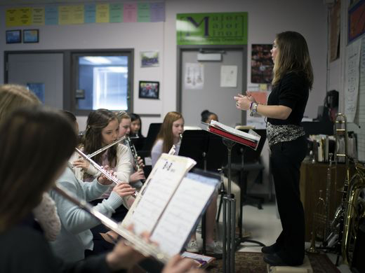 Melody Oneschuk conducts a piece performed by her students after a workshop with the Mid-Atlantic Symphony Orchestra Tuesday, March 17 in Selbyville. (photo by Joe Lamberti)
