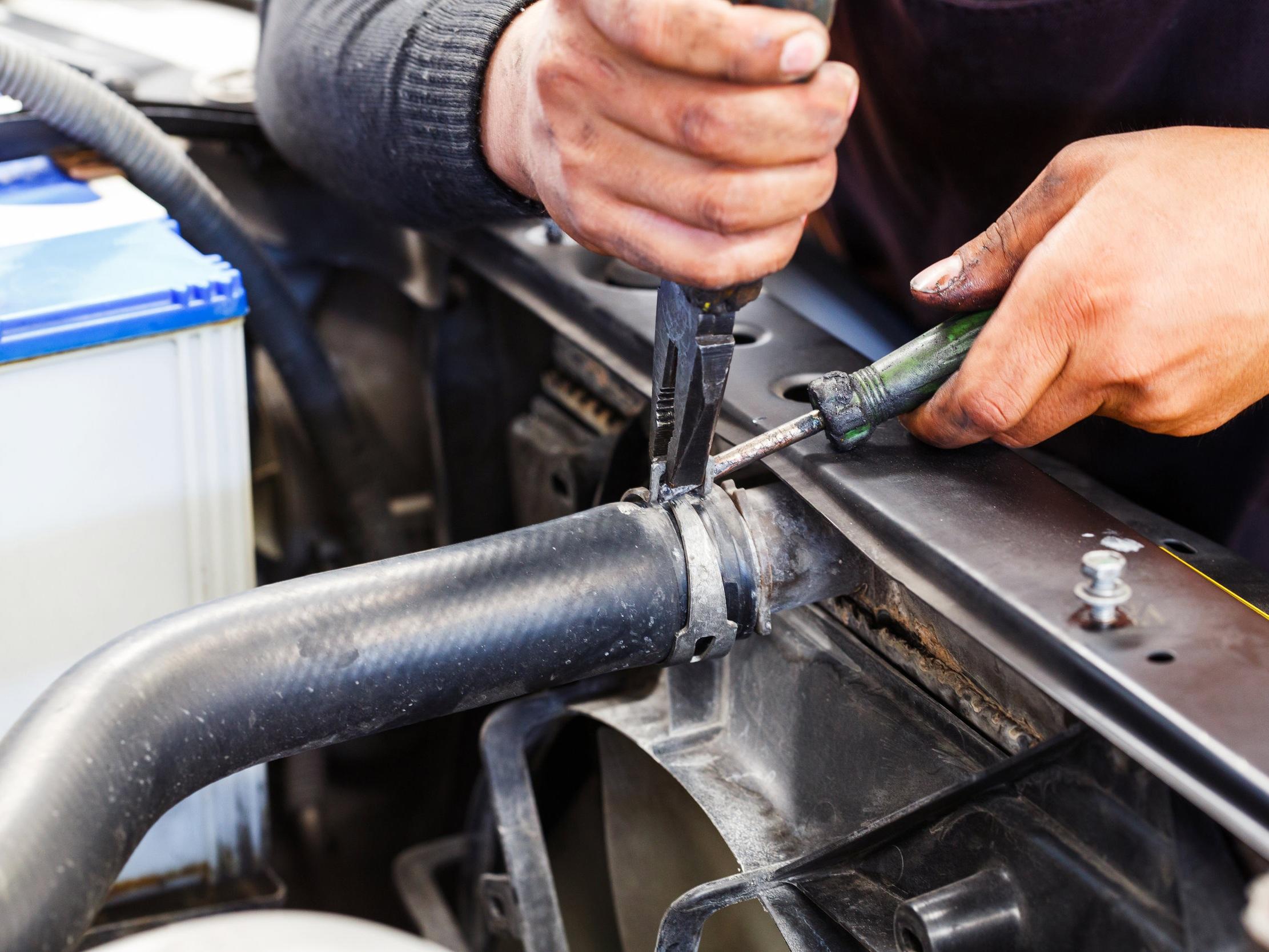 bigstock-Repairing-Car-Radiator-119763653.jpg