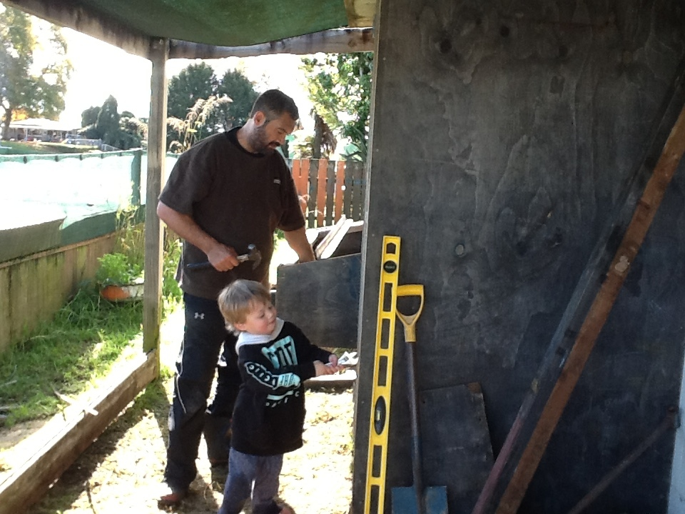 Working hard to get the chicken coup completed for our new feathered friends.