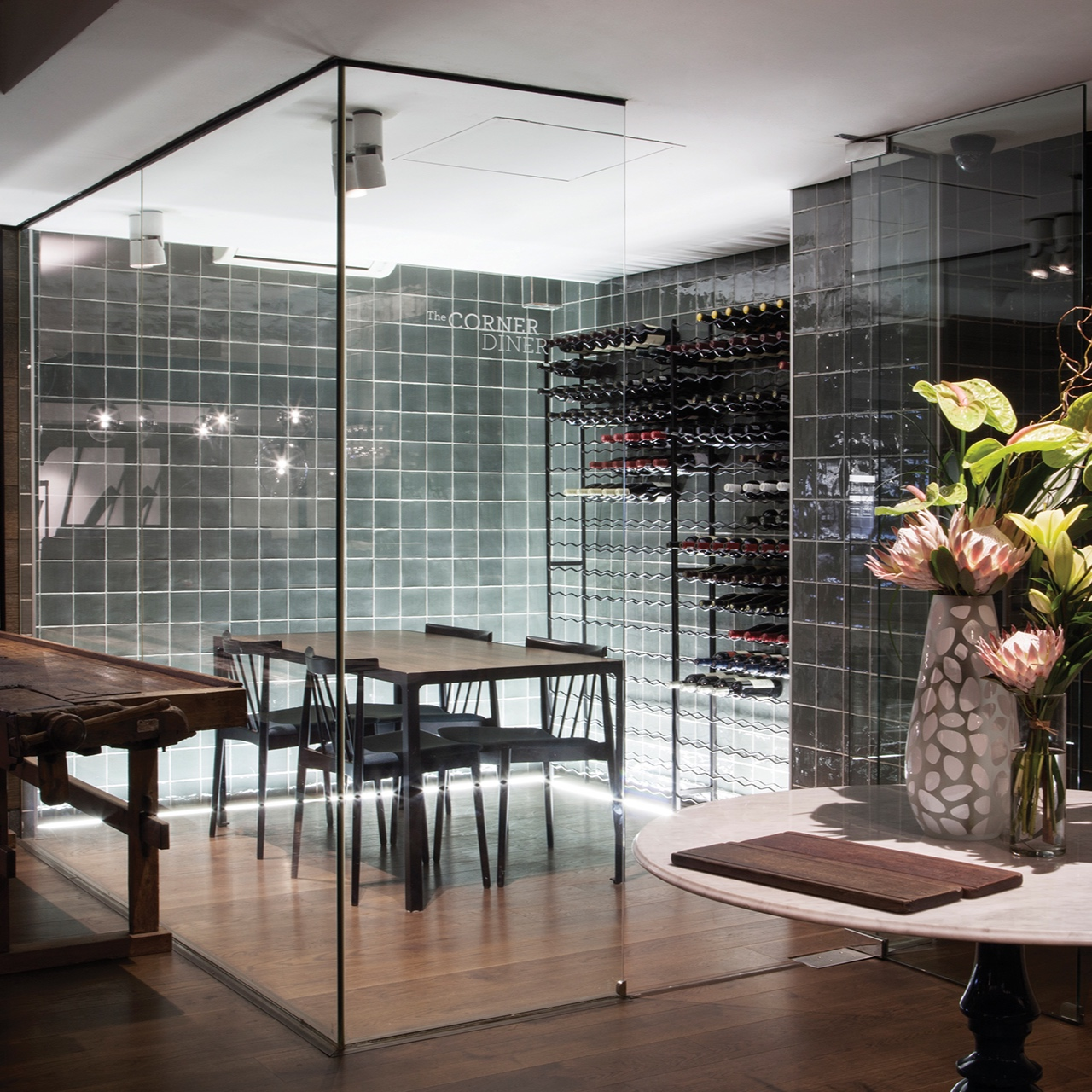 the corner diner - A unique cellar-like space with a striking glass façade and a backdrop of fine wines.