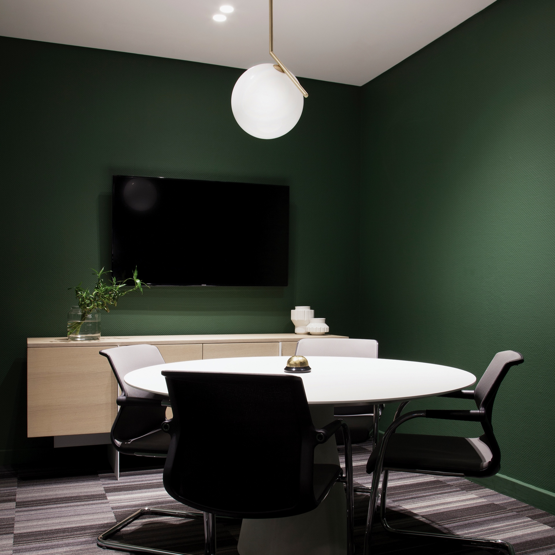 Upper Ninth Lane - A modern styled boardroom with an architectural backdrop and vibrant furnishings.