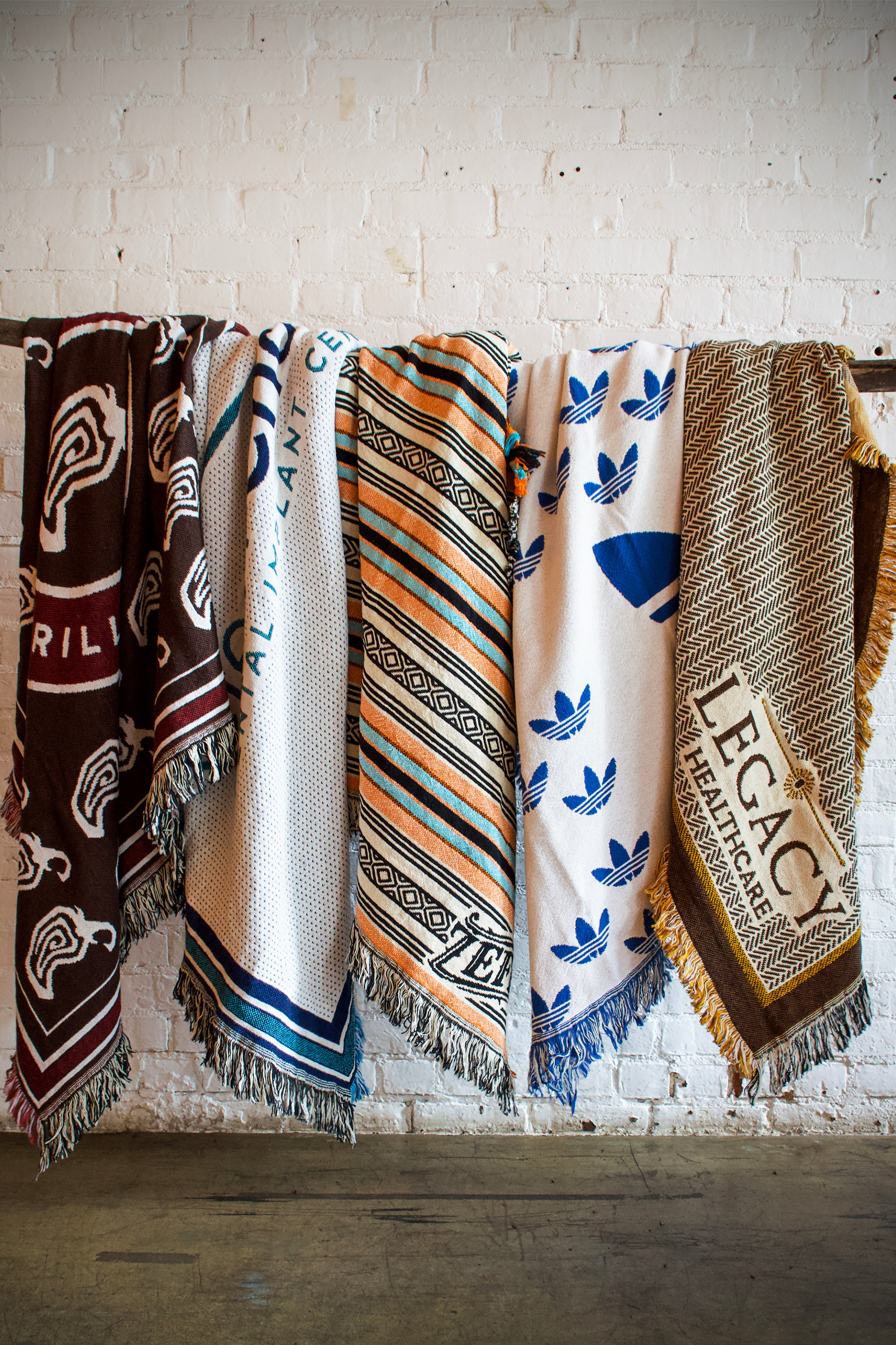 Throws - A timeless product paired with innovative design is perfect for events, client gifts, holiday gifts, promotional branding, retail and more. Our cotton woven throws beautifully capture simple logos or full color artwork. Available in various sizes and constructions to fit any budget.