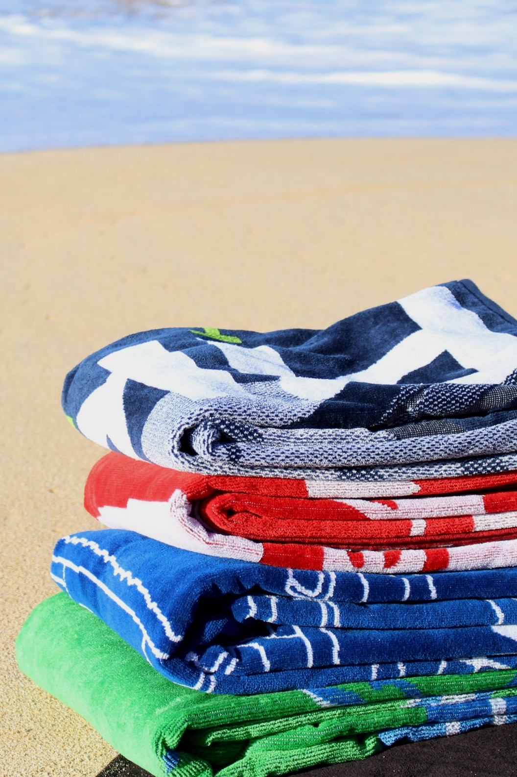 Towels - Luxurious beach, sport and golf towels made of 100% cotton. A woven design will withstand the test of time versus sublimation or screen-printing. It will not fade or wash away. Our towels will remain soft and absorbent for years to come.