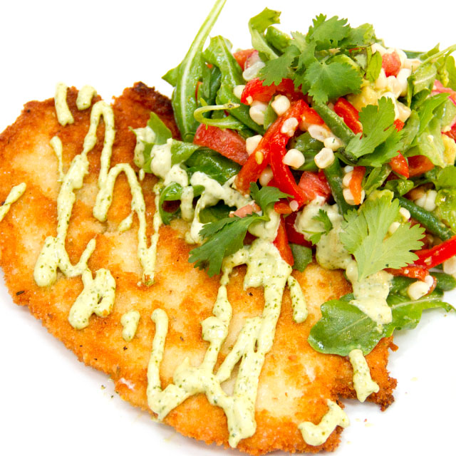 Chicken Milanesa with Avacado and tomato salad.jpg