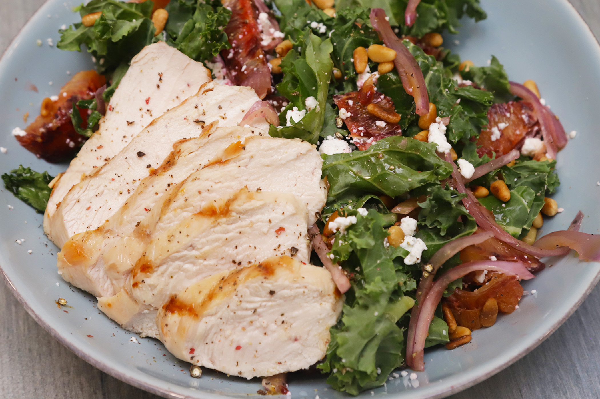 Easy Kale Salad With Blood Oranges, Pine Nuts & Goat Cheese
