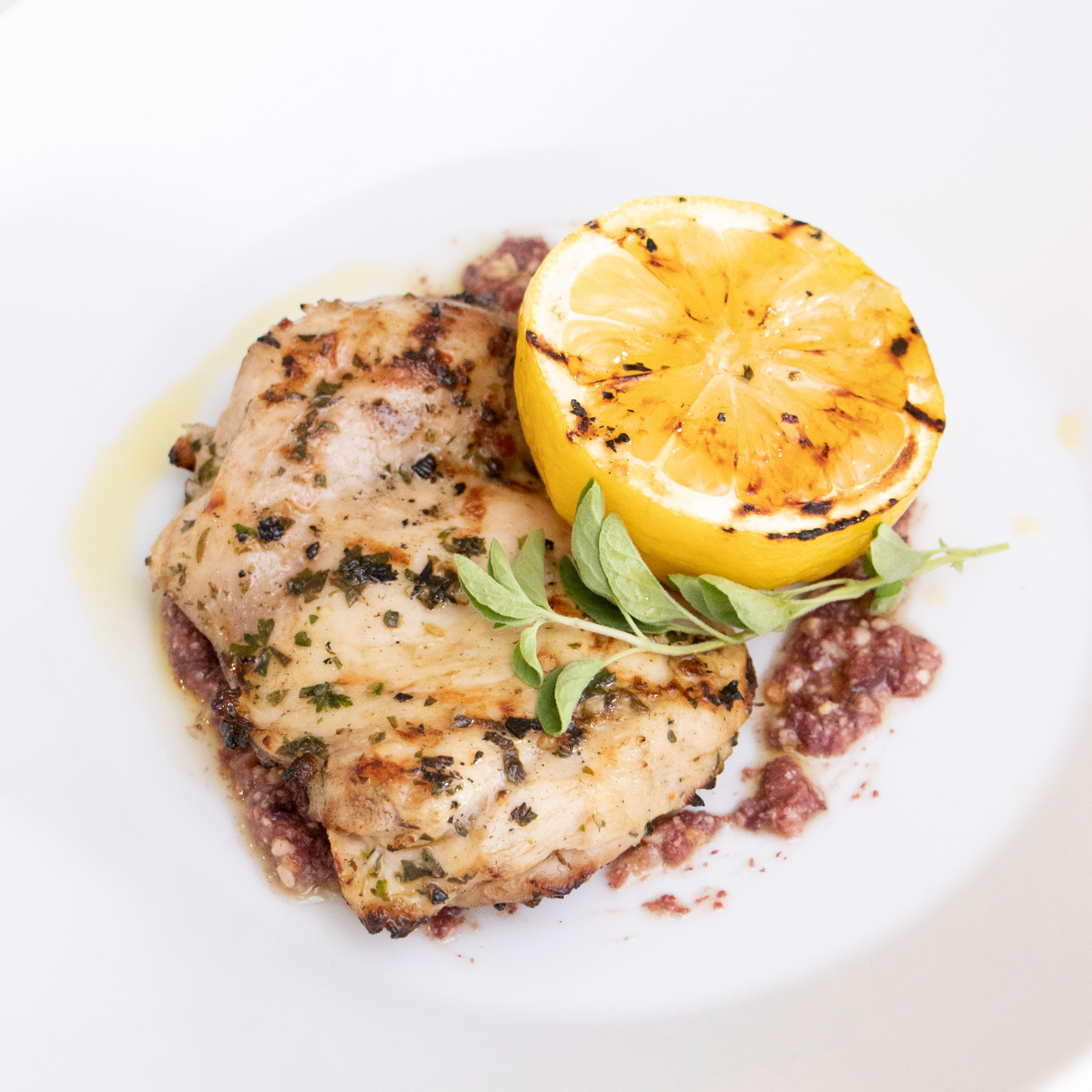 Lemon-Calabrian Chile Chicken Thighs With Black Olive Pesto